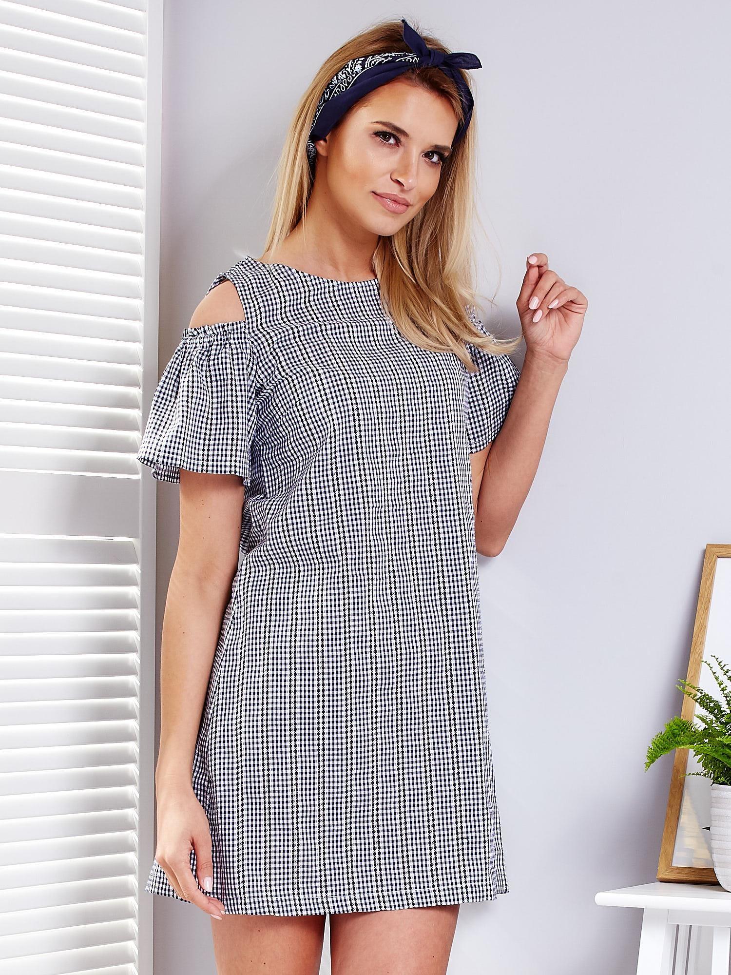 93c47056 Granatowa sukienka w kratkę z falbankami na rękawach
