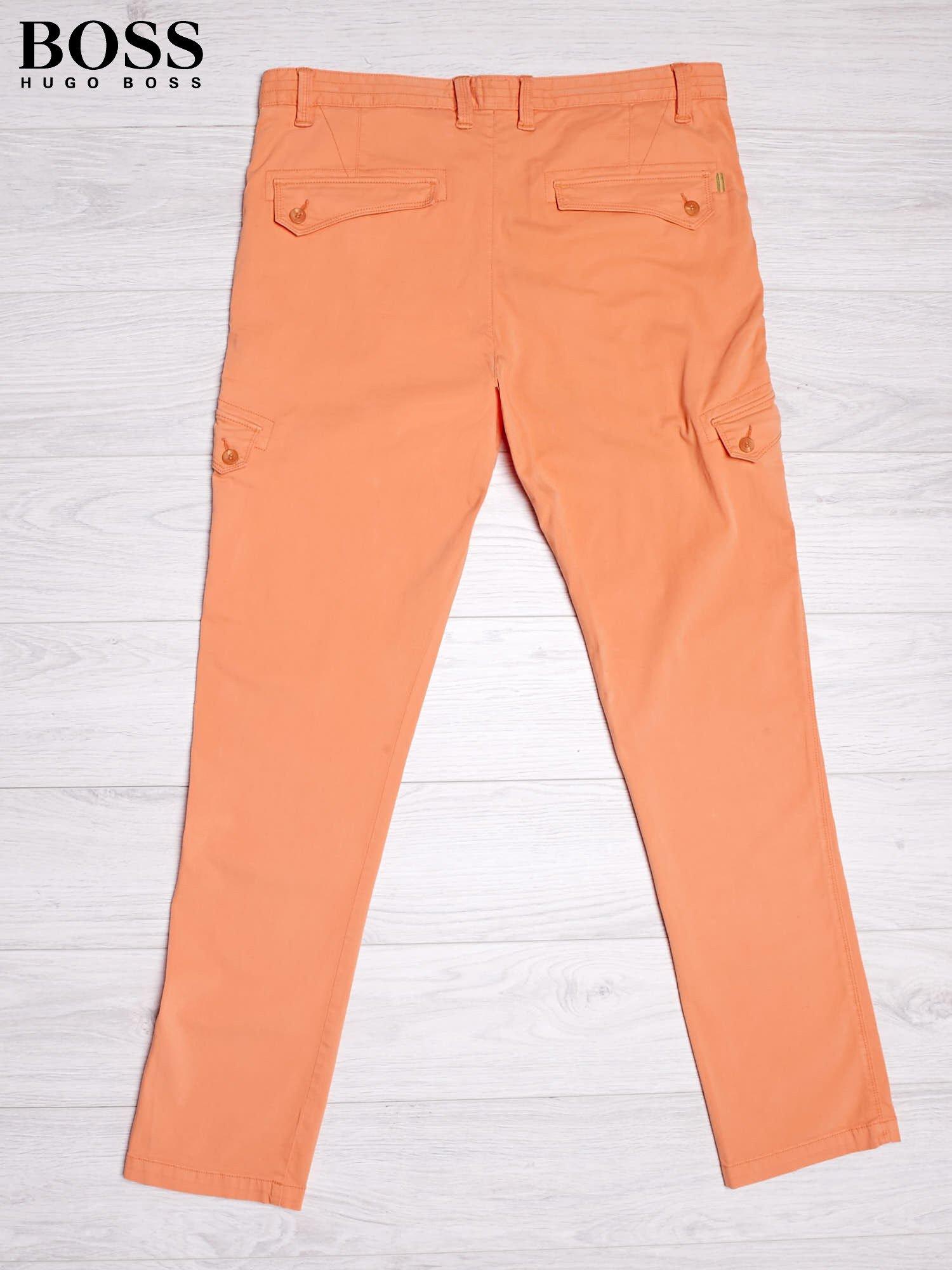 HUGO BOSS Pomarańczowe spodnie męskie z kieszeniami