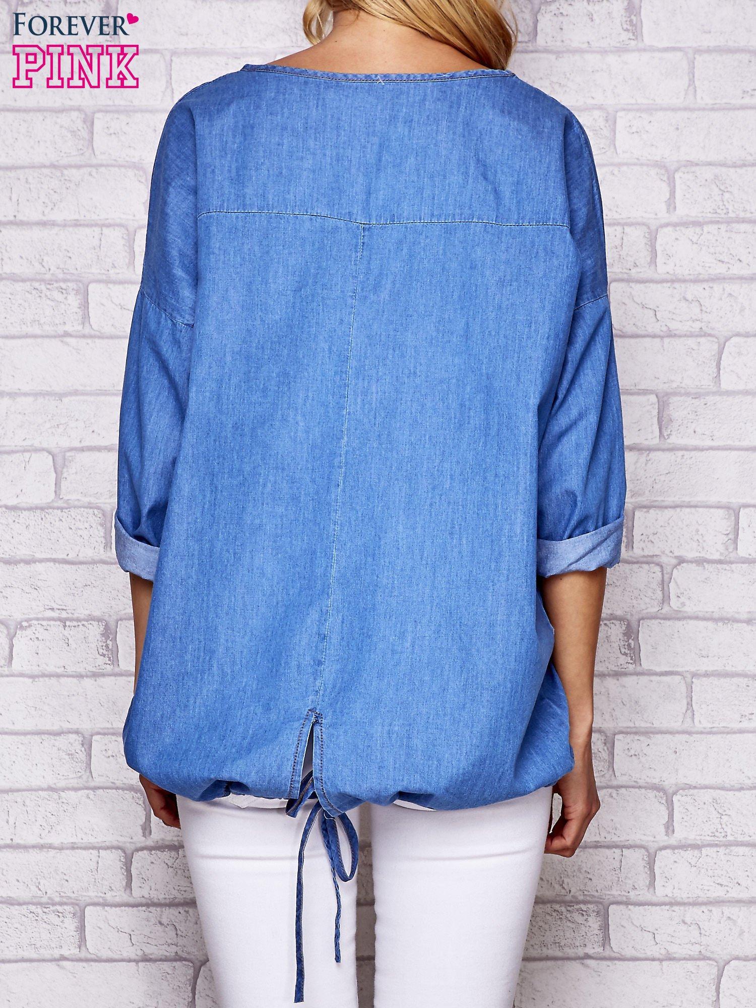 Jasnoniebieska jeansowa tunika ze sznureczkiem                                  zdj.                                  4
