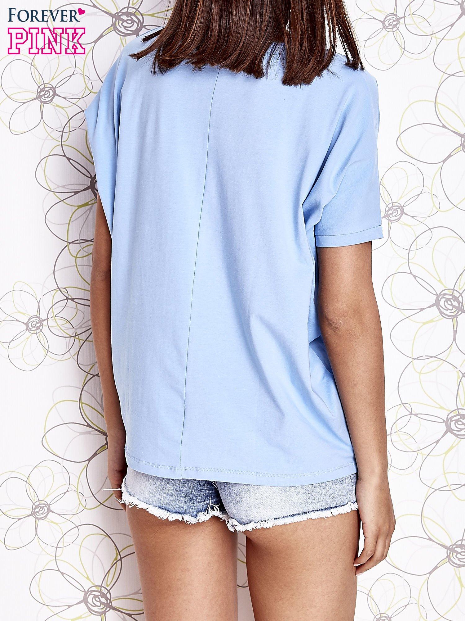 Jasnoniebieski t-shirt oversize                                  zdj.                                  4