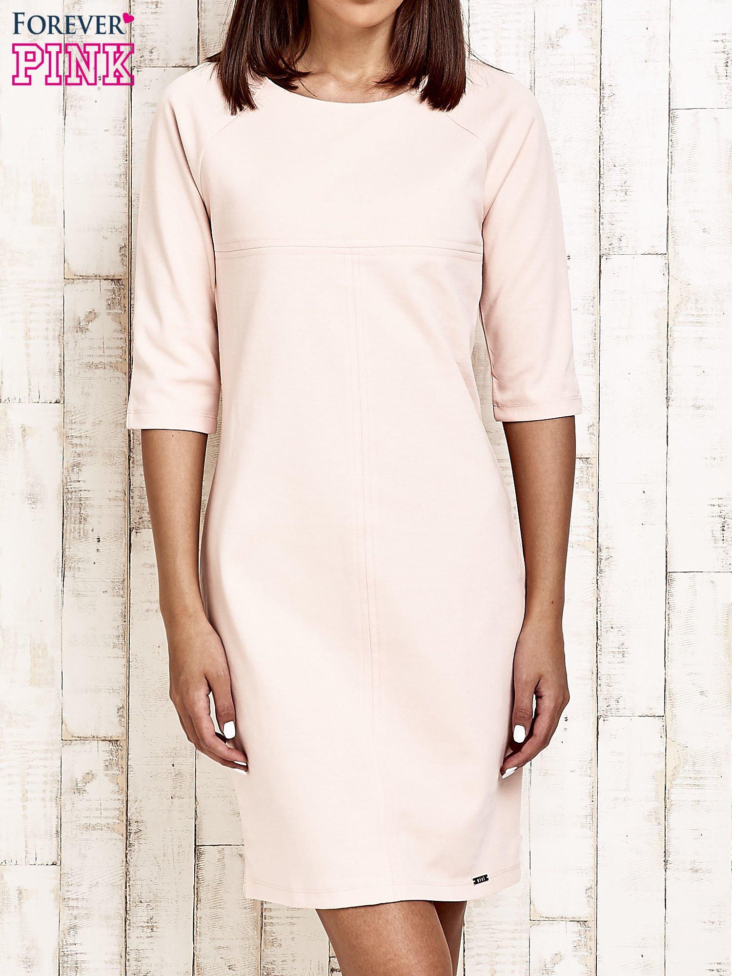 Jasnoróżowa sukienka dresowa z suwakiem z tyłu                                  zdj.                                  1