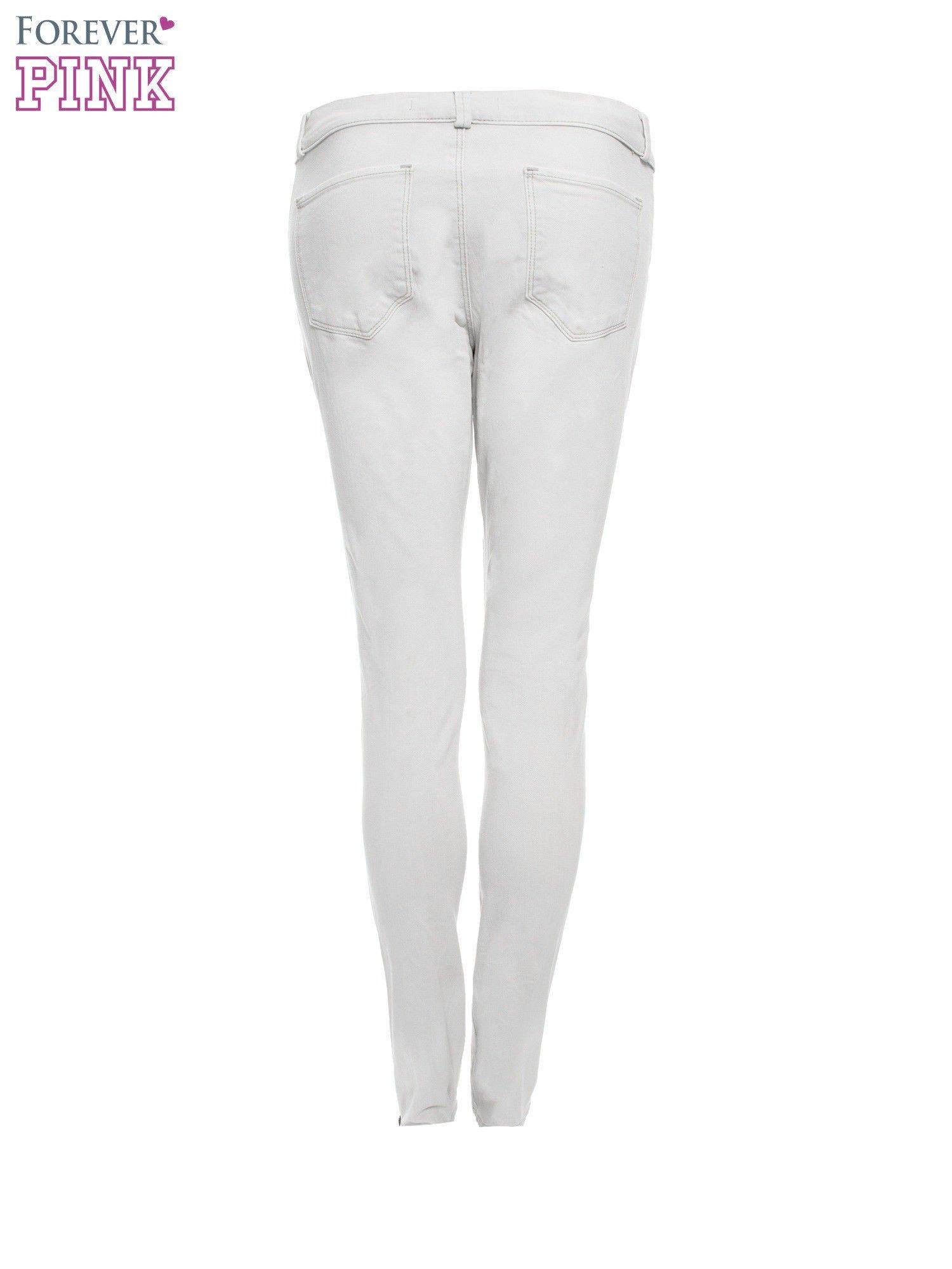 Jasnoszare spodnie jeansowe typu skinny z suwakami na górze i przy nogawkach                                  zdj.                                  5