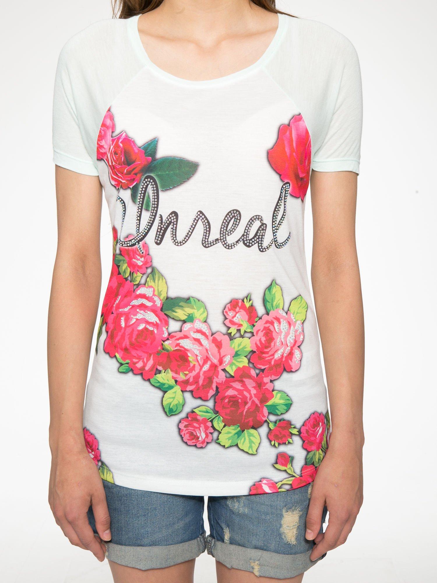 Jasnozielony t-shirt z kwiatowym nadrukiem i napisem UNREAL                                  zdj.                                  7