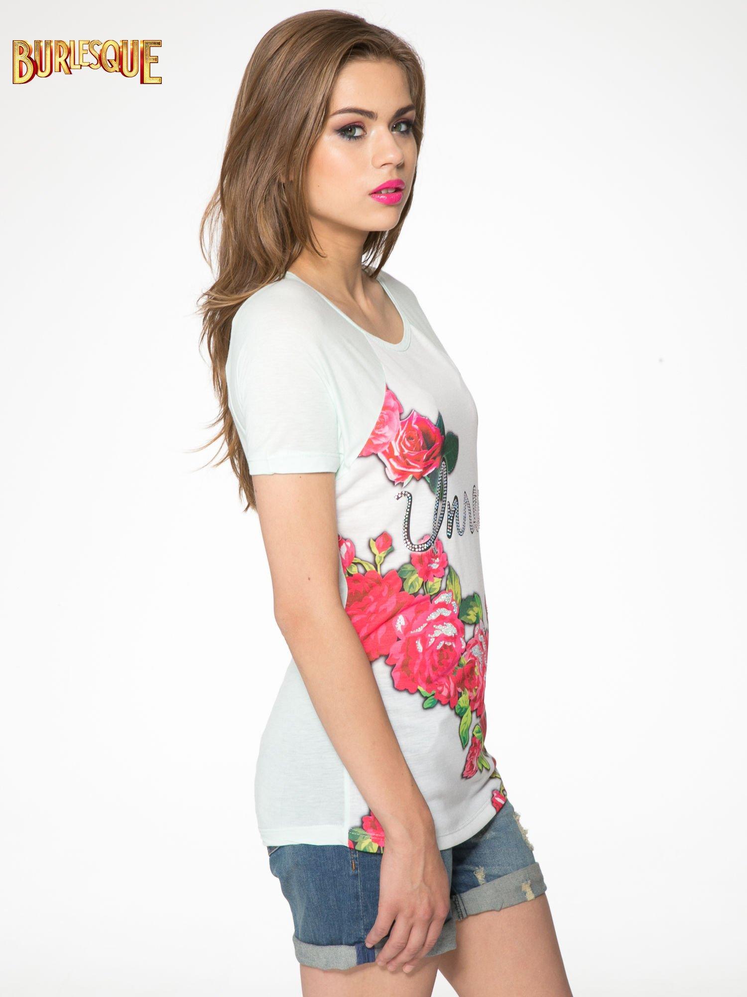 Jasnozielony t-shirt z kwiatowym nadrukiem i napisem UNREAL                                  zdj.                                  3
