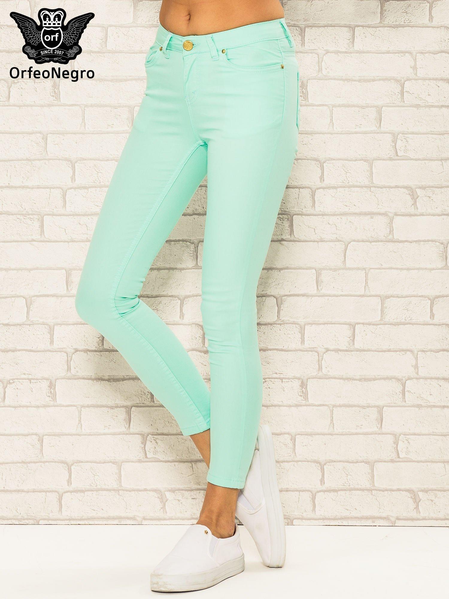 Miętowe spodnie rurki skinny z kieszeniami                                  zdj.                                  1