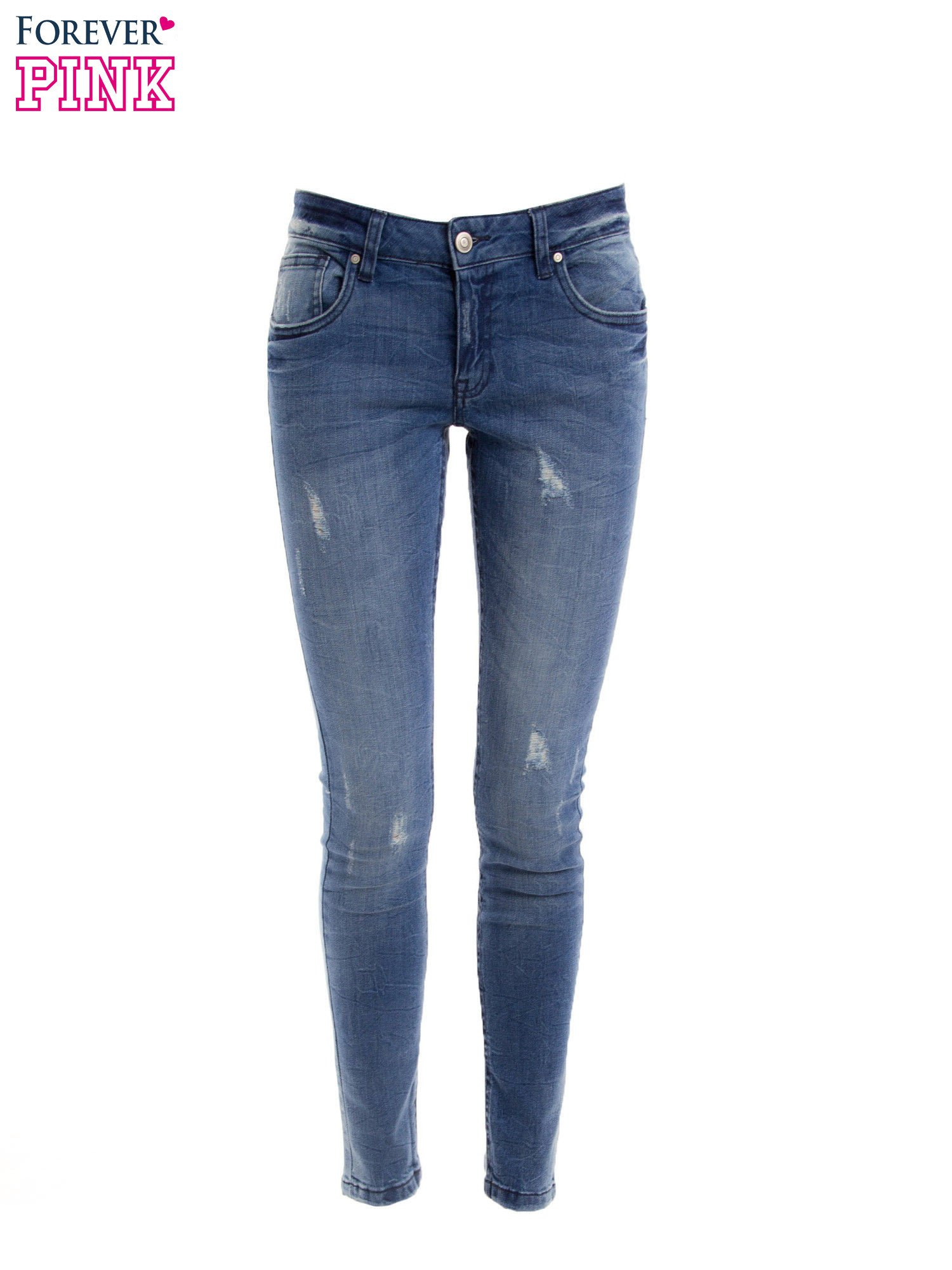 Niebieskie jeansy rurki z przetarciami                                  zdj.                                  8