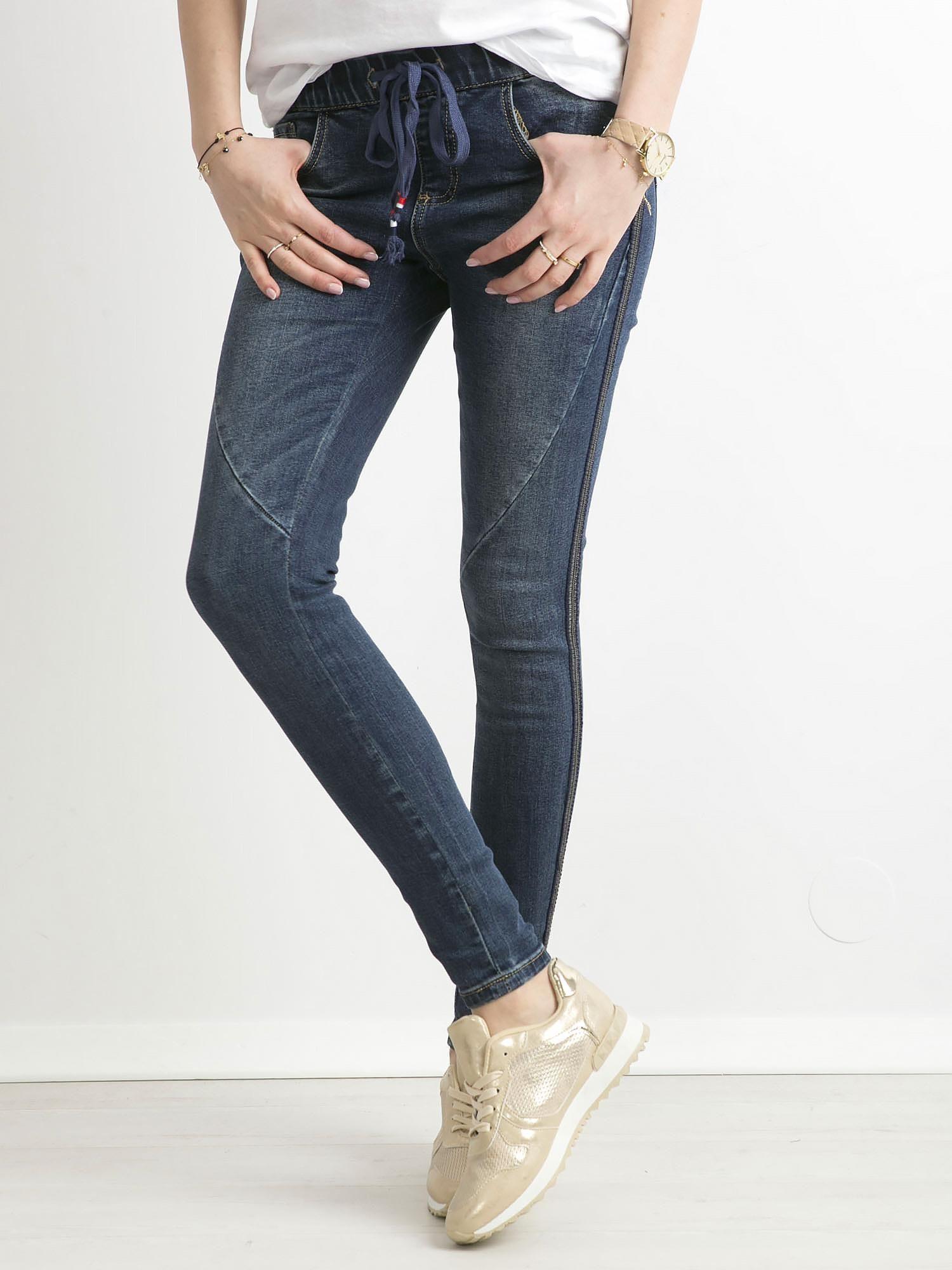78b90a1d Niebieskie jeansy z cekinowym lampasem