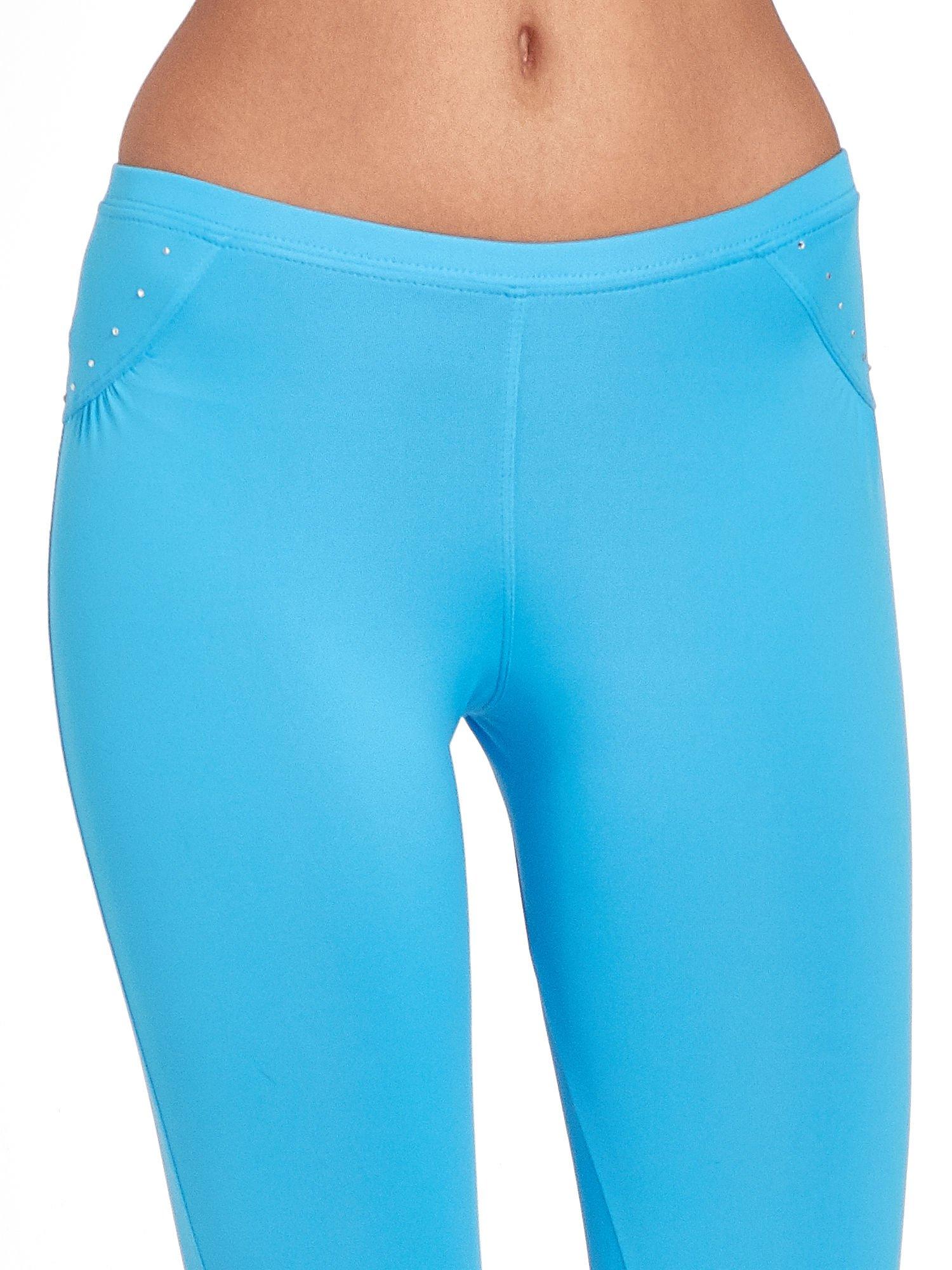 Niebieskie legginsy sportowe termalne z dżetami i ściągaczem                                  zdj.                                  6