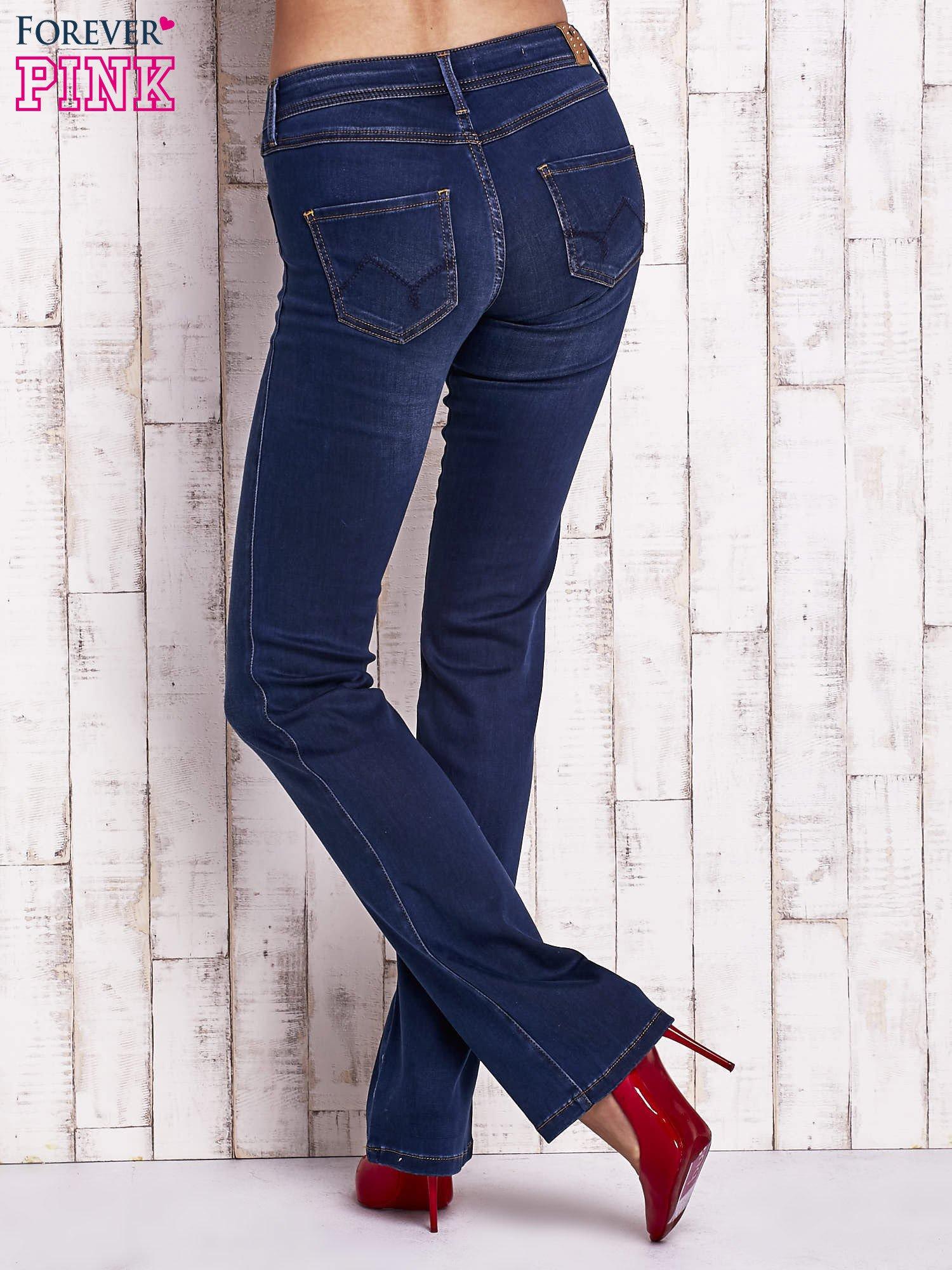 Niebieskie spodnie jeansowe boot cut                                  zdj.                                  3