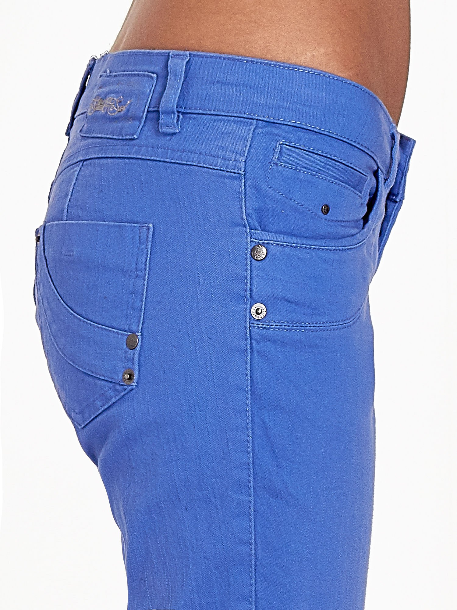 Niebieskie spodnie jeansowe rurki                                  zdj.                                  10