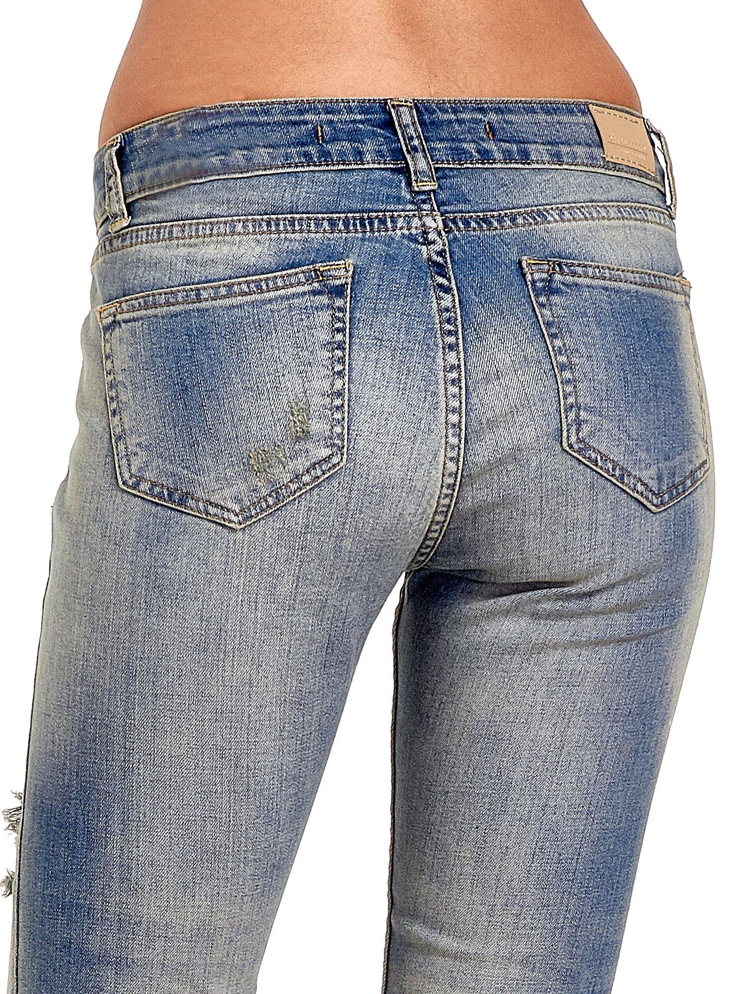 Niebieskie spodnie jeansowe skinny z dziurami                                  zdj.                                  7
