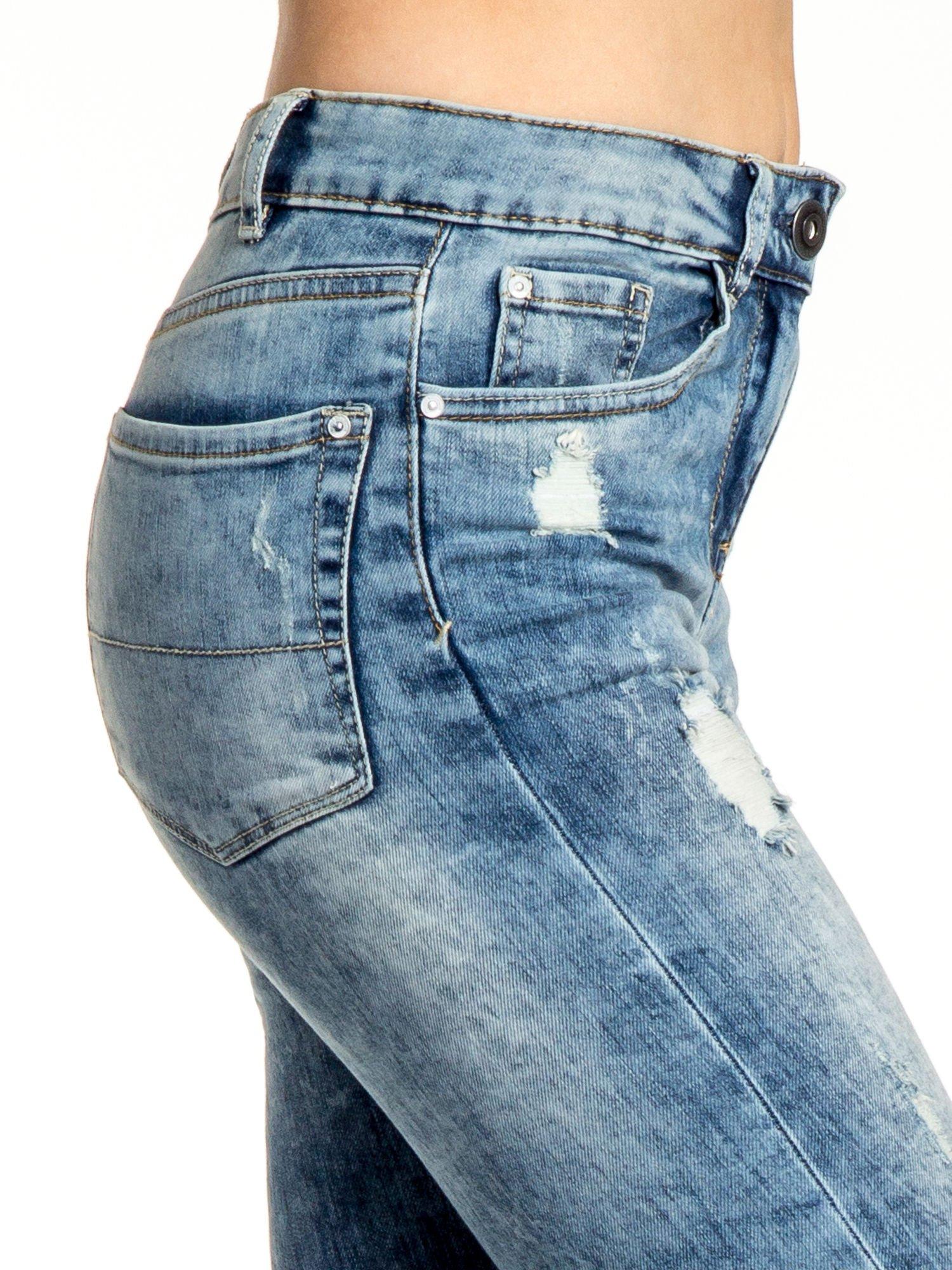 Niebieskie spodnie jeansowe skinny z przetarciami                                  zdj.                                  5