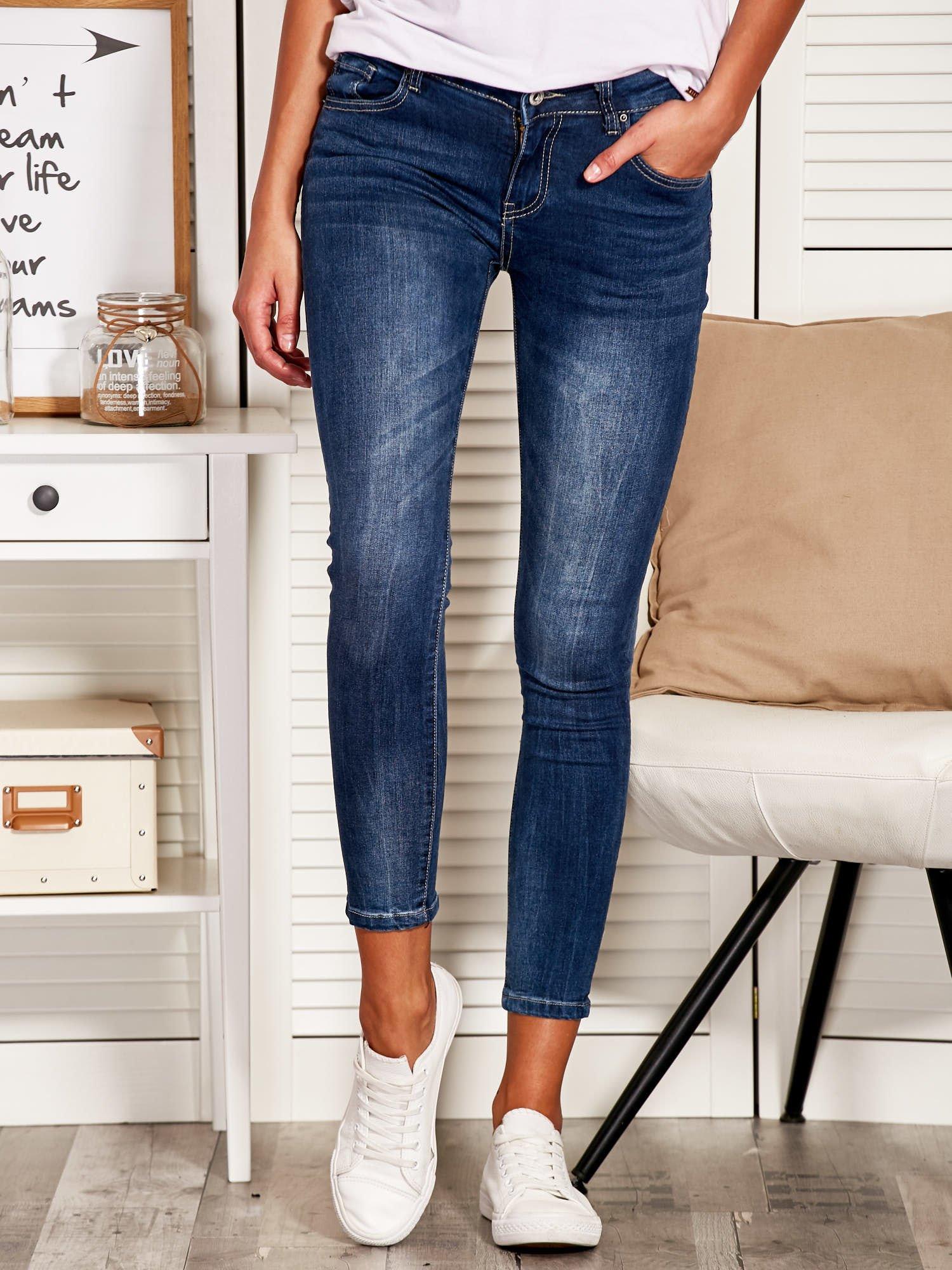 1e48b8a4c3da Niebieskie spodnie jeansowe slim z kokardkami - Spodnie z materiału ...
