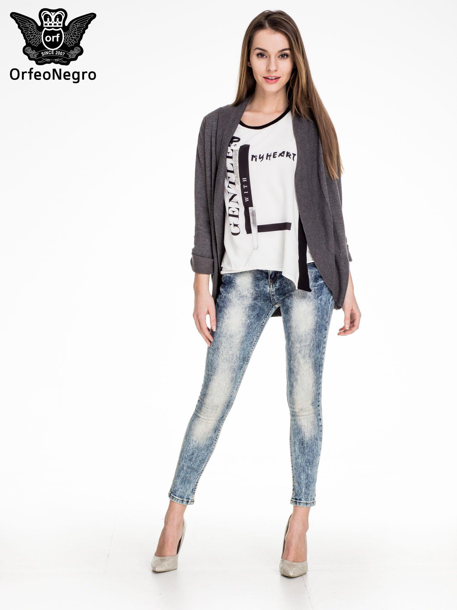 Niebieskie spodnie skinny jeans marmurki z rozjaśnianą nogawką                                  zdj.                                  2