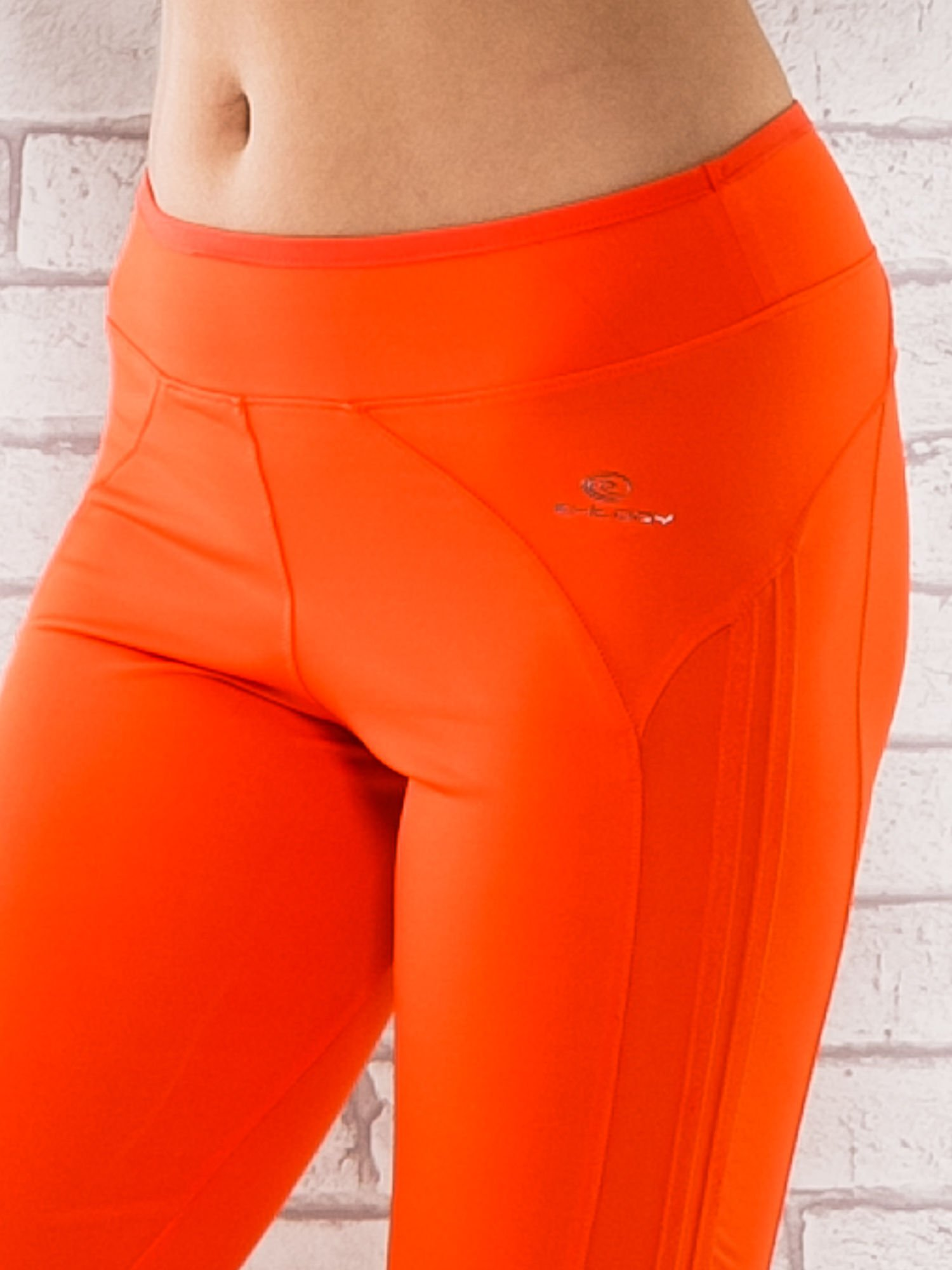 Pomarańczowe legginsy 3/4 sportowe termalne z lampasami                                  zdj.                                  4