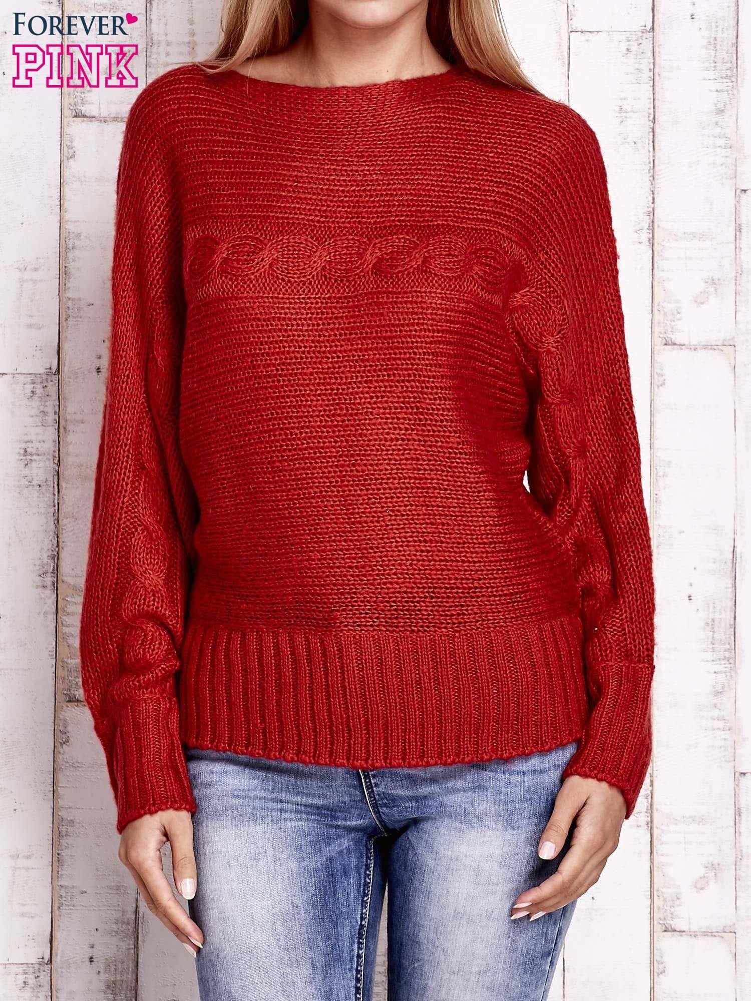 Pomarańczowy sweter z warkoczowym splotem                                  zdj.                                  1