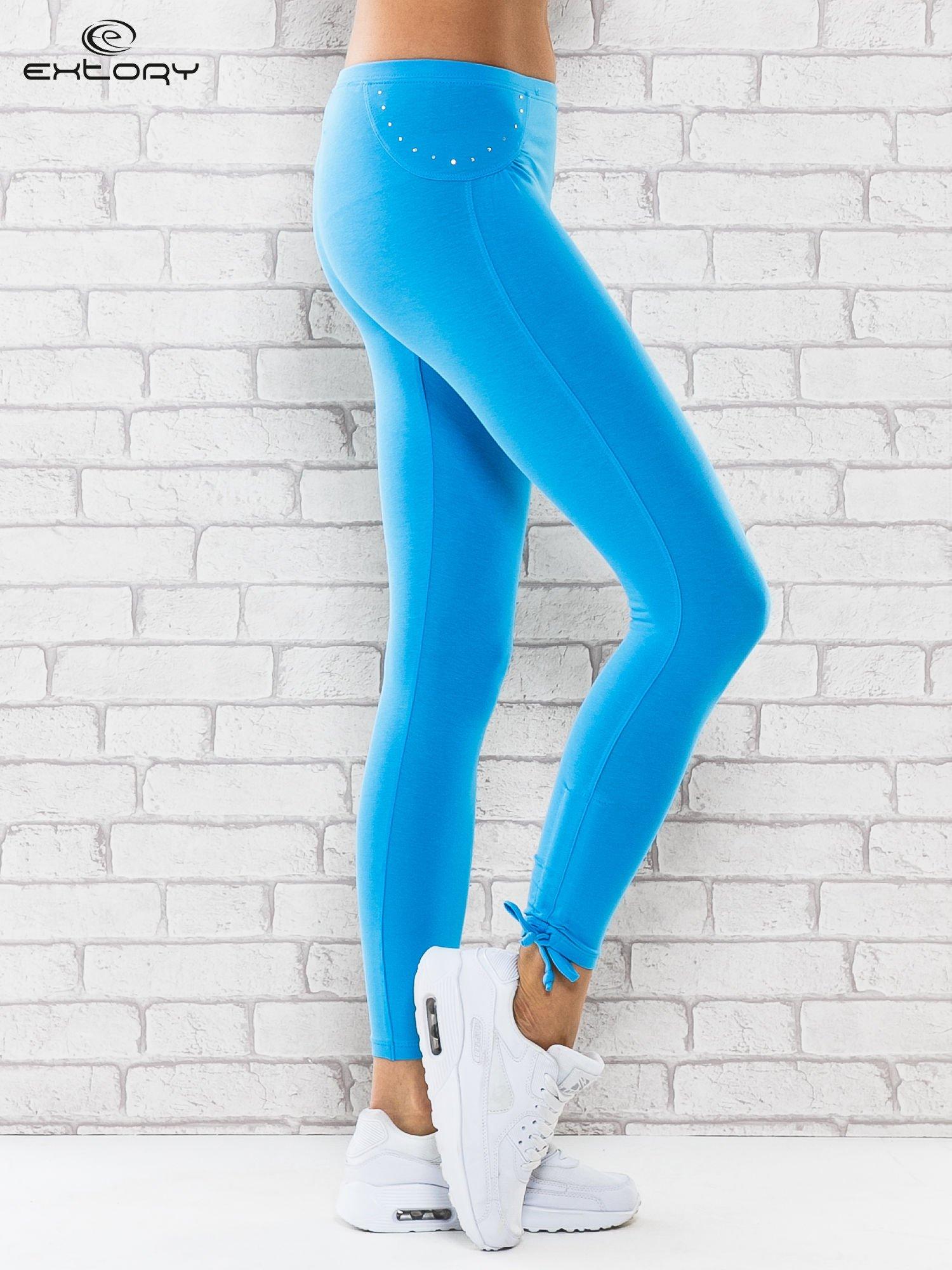 1a6e64c6b4428d Turkusowe legginsy sportowe 7/8 z wiązaniem - Spodnie legginsy ...