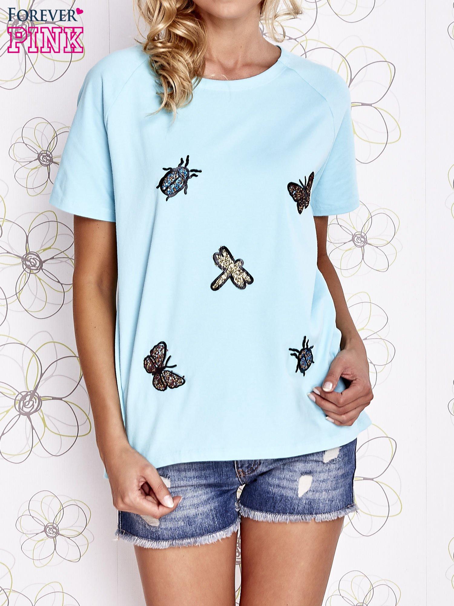 Turkusowy t-shirt z aplikacją owadów                                   zdj.                                  1
