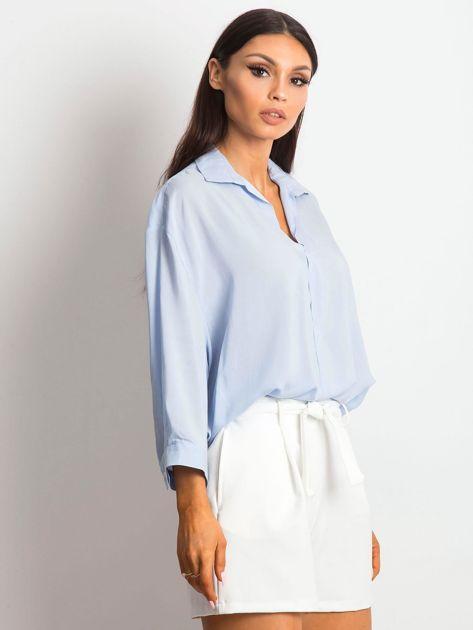 Niebieska bluzka o luźnym kroju                              zdj.                              3
