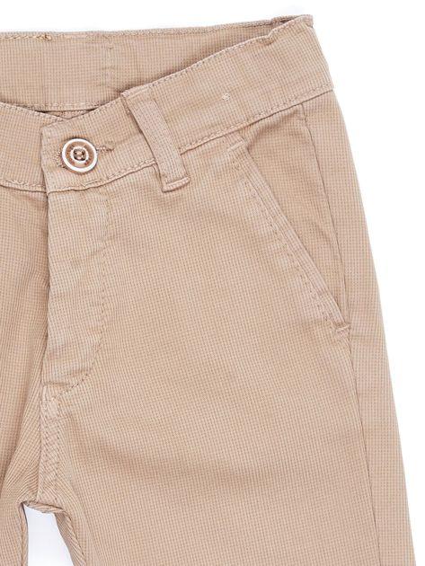 Beżowe materiałowe spodnie dla chłopca                               zdj.                              4