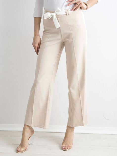 Beżowe szerokie spodnie z lampasami                              zdj.                              1