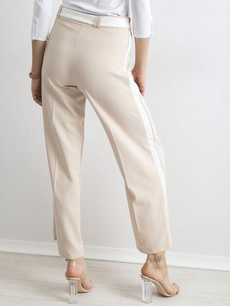 Beżowe szerokie spodnie z lampasami                              zdj.                              2