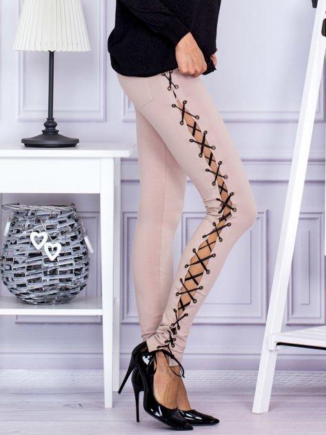 Beżowe sznurowane legginsy                               zdj.                              5