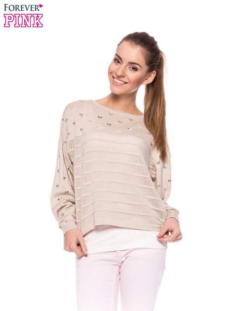Beżowy ażurowy sweter w serduszka                                  zdj.                                  1
