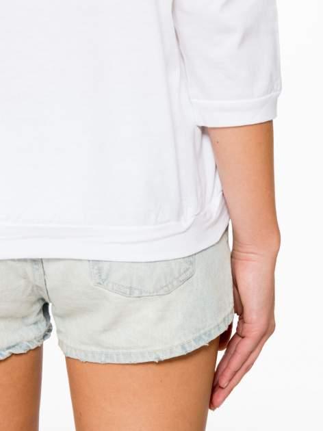 Biała bluzka z rękawem 3/4 i lekkim ściągaczem na dole                                  zdj.                                  9