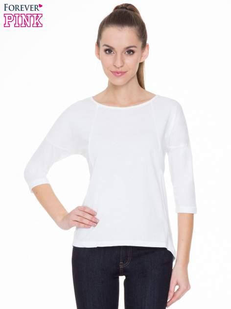 Biała gładka bluzka z ozdobnymi przeszyciami                                  zdj.                                  1