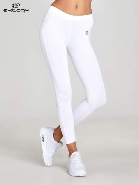 Białe legginsy sportowe termalne z drapowaniem                                  zdj.                                  1