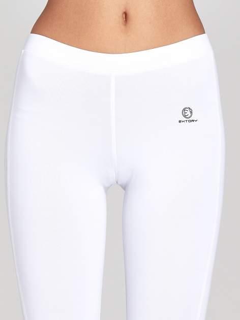 Białe legginsy sportowe termalne z drapowaniem                                  zdj.                                  6