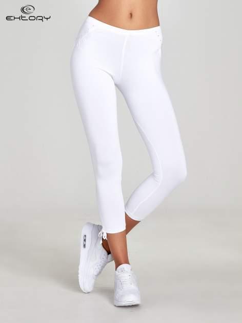 Białe legginsy sportowe termalne z dżetami i ściągaczem