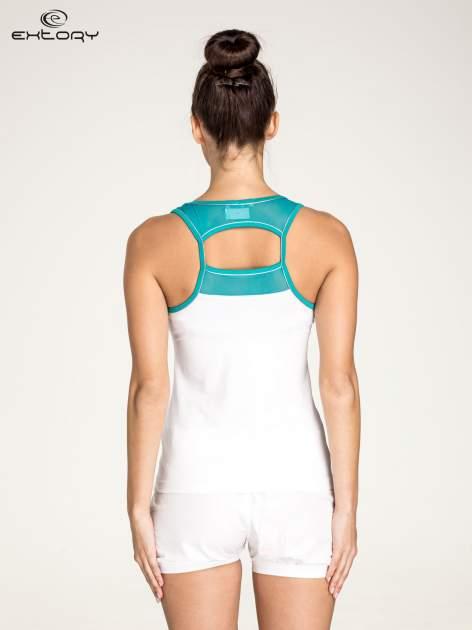 Biały top sportowy V-neck z turkusową lamówką                                  zdj.                                  4