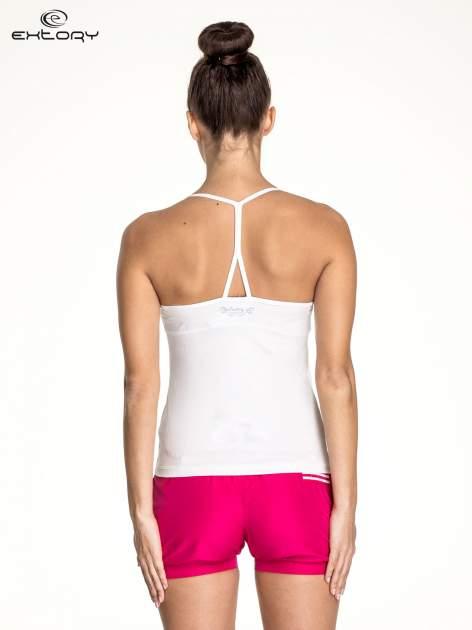 Biały top sportowy z siateczką i ramiączkami w kształcie litery T na plecach                                  zdj.                                  4