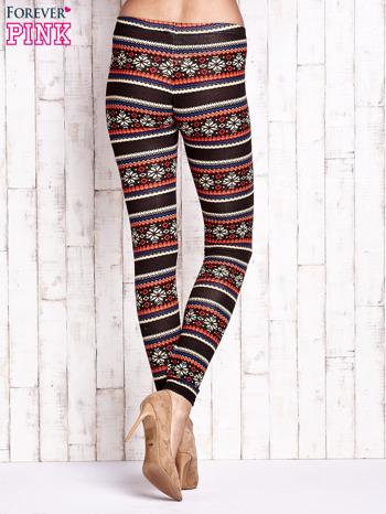 Brązowe legginsy z zimowym nadrukiem