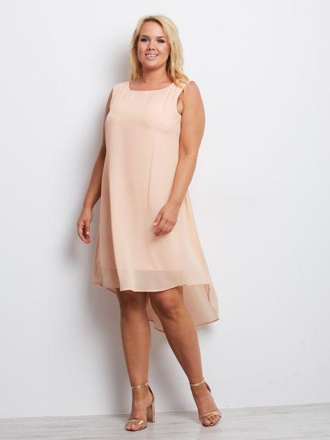 Brzoskwiniowa sukienka plus size Representative