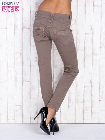 Ciemnobeżowe spodnie z kieszonkami na suwak                                  zdj.                                  2