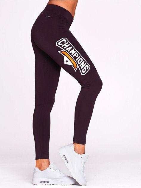 Ciemnofioletowe legginsy na siłownię z nadrukiem CHAMPIONS                                  zdj.                                  1