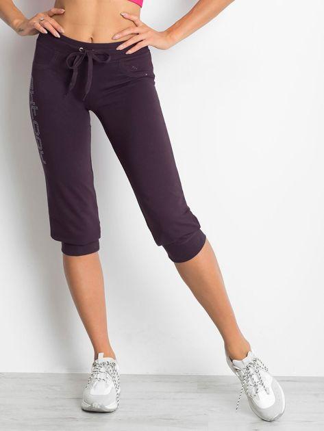 Ciemnofioletowe spodnie dresowe capri z napisem EXTORY                                  zdj.                                  4