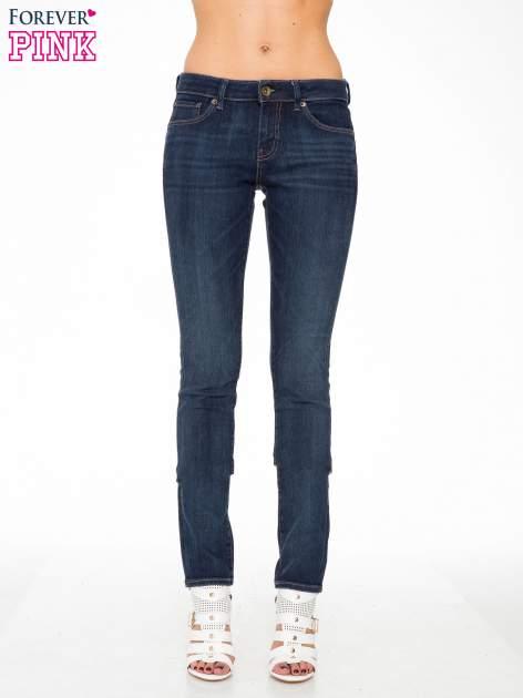 Ciemnoniebieskie spodnie jeansowe rurki                                   zdj.                                  1