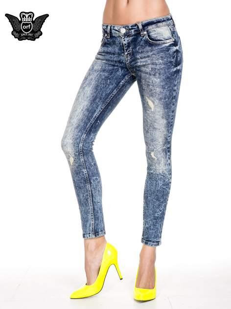 Ciemnoniebieskie spodnie jeansowe rurki marmurki z przetarciami                                  zdj.                                  1