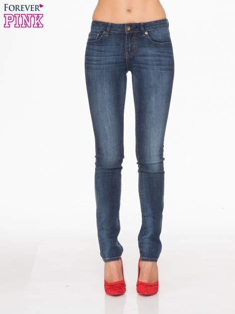 Ciemnoniebieskie spodnie jeansowe rurki z cieniowaniem                                  zdj.                                  1