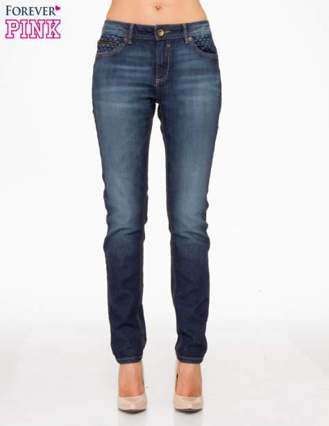 Ciemnoniebieskie spodnie jeansowe rurki z pikowanymi wstawkami