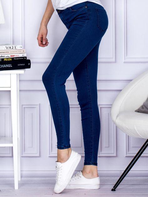 Ciemnoniebieskie spodnie jeansowe slim z wysokim stanem                              zdj.                              3