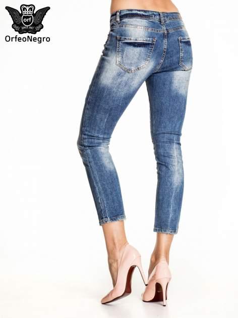 Ciemnoniebieskie spodnie skinny jeans z łatami                                  zdj.                                  4