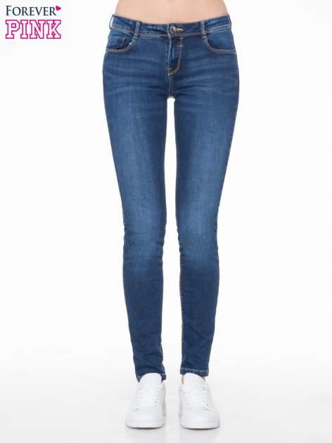 Ciemnoniebieskie spodnie typu skinny jeans z cieniowaniem                                  zdj.                                  1