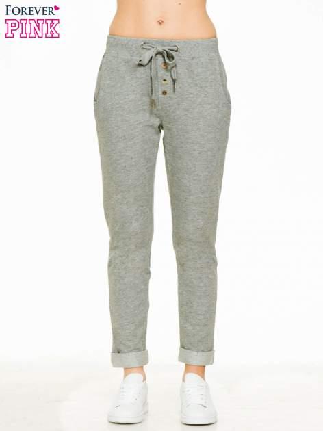 Ciemnoszare spodnie dresowe z guzikami wiązane w pasie                                  zdj.                                  1