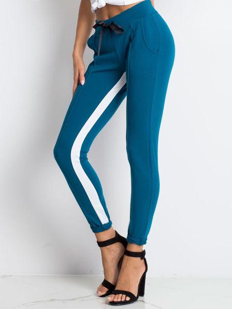 Ciemnoturkusowe spodnie dresowe Defined                              zdj.                              3