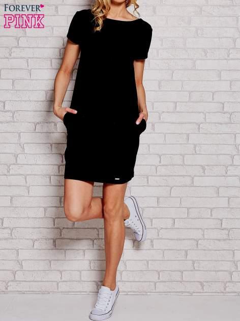 Czarna sukienka dresowa z kieszeniami                                  zdj.                                  1